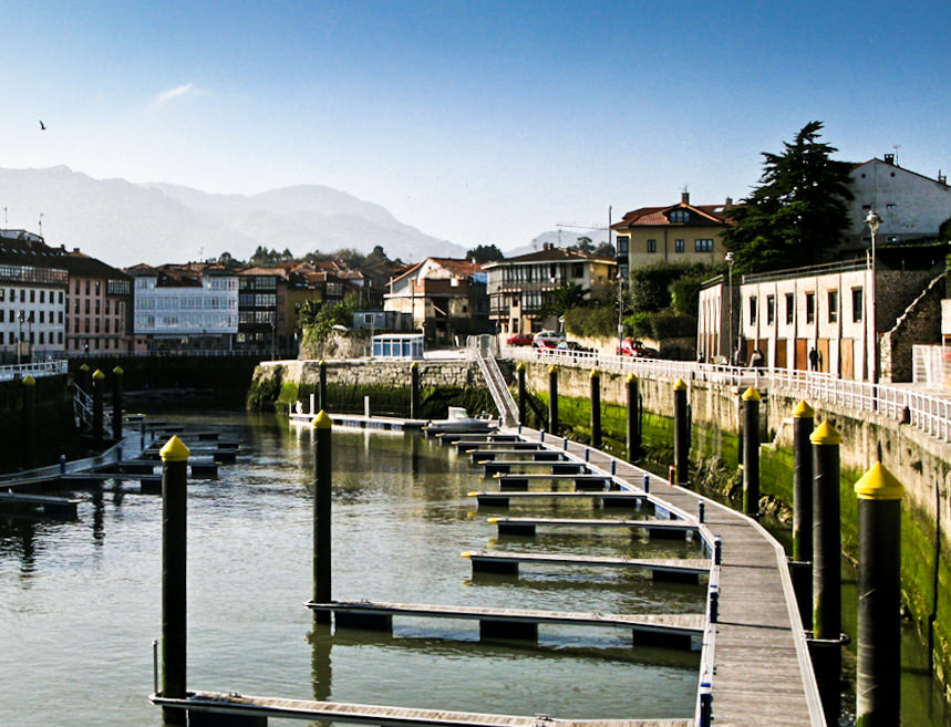 A town with a river and docks for boats in Asturias