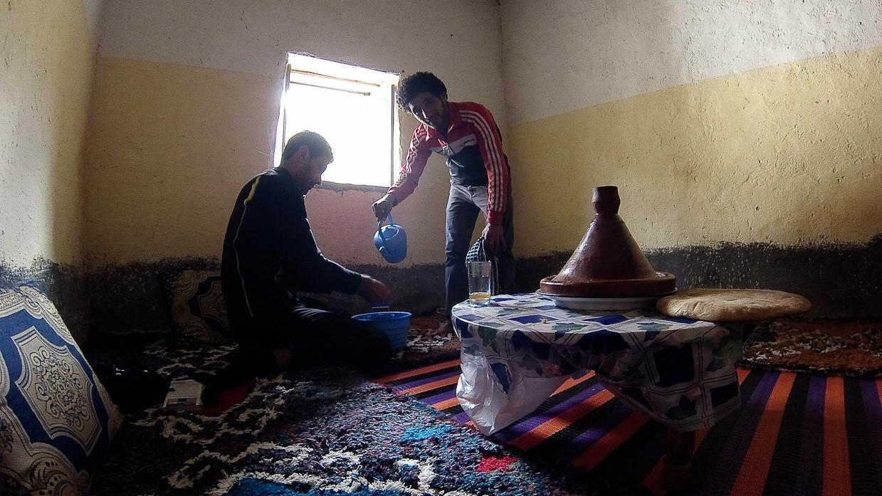 Eid al-Adha. A men washing his hands before eating the day of Eid al-Adha